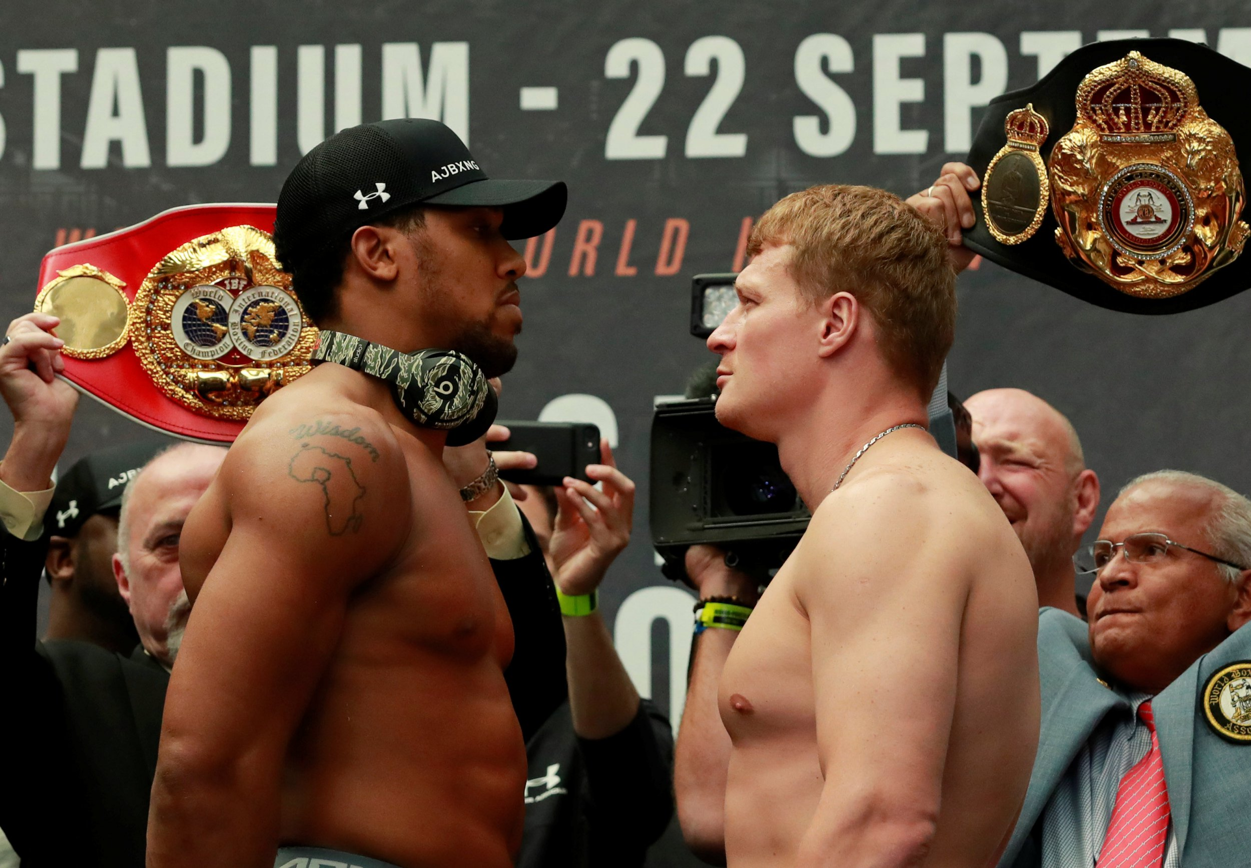 Boxing - Anthony Joshua & Alexander Povetkin Weigh-In - London, Britain - September 21, 2018 Anthony Joshua and Alexander Povetkin go head to head during their weigh-in Action Images via Reuters/Andrew Couldridge