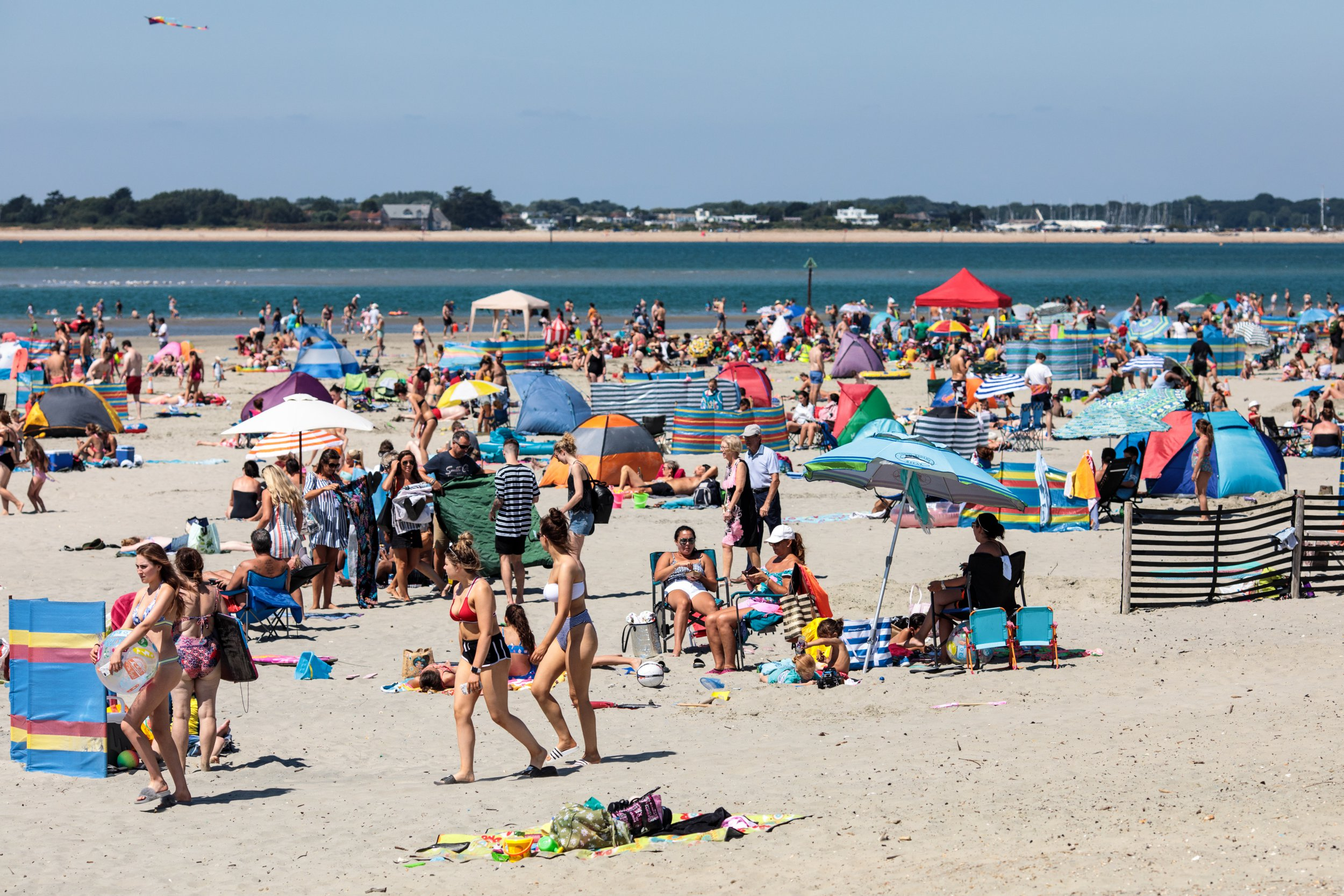 CHICHESTER, ENGLAND - JULY 23: Beachgoers gather on West Wittering Beach during hot weather on the first day of the Summer school holidays on July 23, 2018 in Chichester, England. Today has been the hottest day of 2018 with temperatures rising to 33.3 degrees celsius in some areas. The Met Office have issued an amber weather warning to stay out of the sun between now and Friday as temperatures could continue to rise to 35 degrees celsius. (Photo by Jack Taylor/Getty Images)