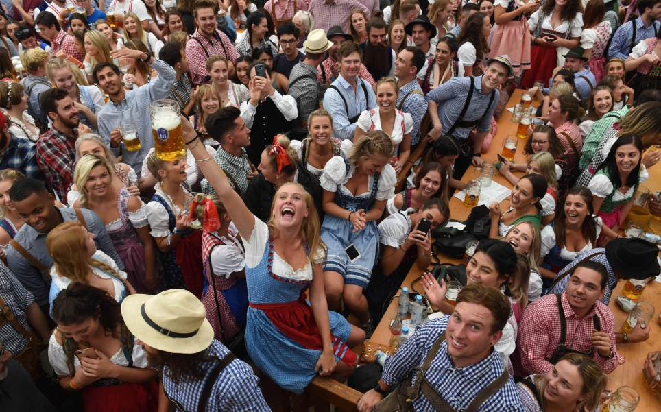 Visitors drink beer during the 185th Oktoberfest, Munich's annual beer festival, on September 22, 2018 in Munich, southern Germany. - The world's largest beer festival is held from September 22 until October 7, 2018. (Photo by Christof STACHE / AFP)CHRISTOF STACHE/AFP/Getty Images