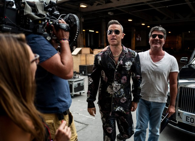 STRICT EMBARGO - NO USE BEFORE 00:01GMT SUNDAY 23RD SEPTEMBER 2018 - EDITORIAL USE ONLY. NO MERCHANDISING. Mandatory Credit: Photo by Dymond/Thames/Syco/REX (9888839ah) Robbie Williams and Simon Cowell 'The X Factor' TV show, Series 15, Episode 8, UK - 23 Sep 2018