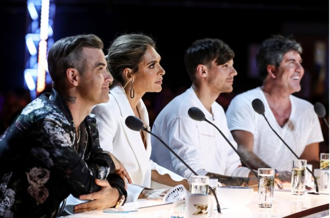 STRICT EMBARGO - NO USE BEFORE 00:01GMT SUNDAY 23RD SEPTEMBER 2018 - EDITORIAL USE ONLY. NO MERCHANDISING. Mandatory Credit: Photo by Dymond/Thames/Syco/REX (9888839ad) Robbie Williams, Ayda Williams, Louis Tomlinson and Simon Cowell during the performance of Atty 'The X Factor' TV show, Series 15, Episode 8, UK - 23 Sep 2018