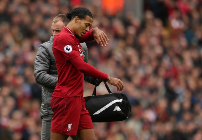 """Soccer Football - Premier League - Liverpool v Southampton - Anfield, Liverpool, Britain - September 22, 2018 Liverpool's Virgil van Dijk receives medical attention after sustaining an injury Action Images via Reuters/Lee Smith EDITORIAL USE ONLY. No use with unauthorized audio, video, data, fixture lists, club/league logos or """"live"""" services. Online in-match use limited to 75 images, no video emulation. No use in betting, games or single club/league/player publications. Please contact your account representative for further details."""