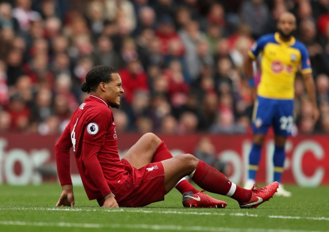 """Soccer Football - Premier League - Liverpool v Southampton - Anfield, Liverpool, Britain - September 22, 2018 Liverpool's Virgil van Dijk goes down after sustaining an injury Action Images via Reuters/Lee Smith EDITORIAL USE ONLY. No use with unauthorized audio, video, data, fixture lists, club/league logos or """"live"""" services. Online in-match use limited to 75 images, no video emulation. No use in betting, games or single club/league/player publications. Please contact your account representative for further details."""