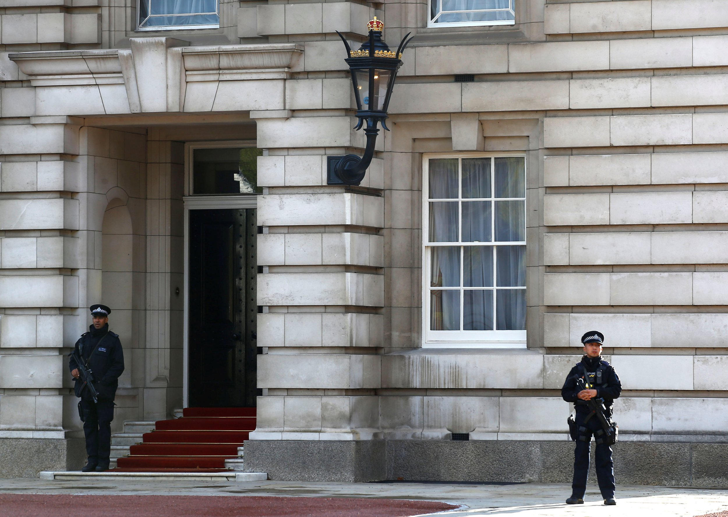 Armed police patrol the grounds of Buckingham Palace after a man was arrested at the visitor entrance of Britain's Queen Elizabeth's residence in London, Britain, September 23, 2018. REUTERS/Henry Nicholls