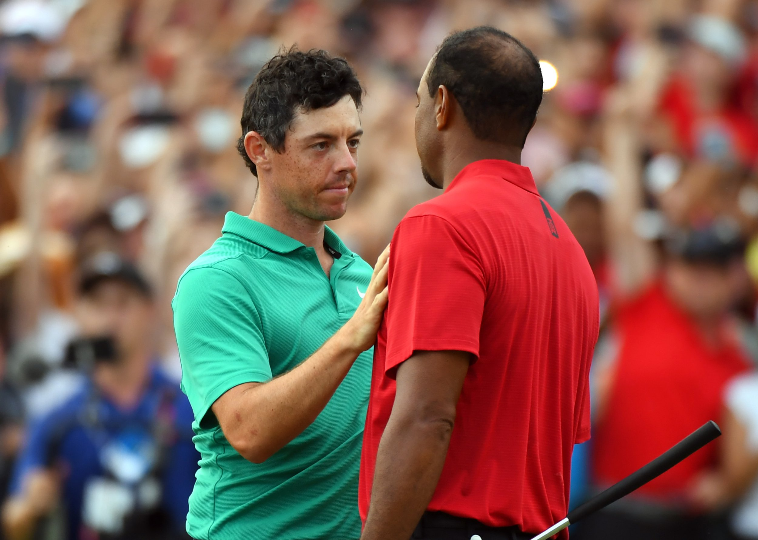 SIPA USA via PA Images Sep 23, 2018; Atlanta, GA, USA; Tiger Woods shakes hands with Rory McIlroy after winning the Tour Championship golf tournament at East Lake Golf Club. Mandatory Credit: Christopher Hanewinckel-USA TODAY Sports/Sipa USA