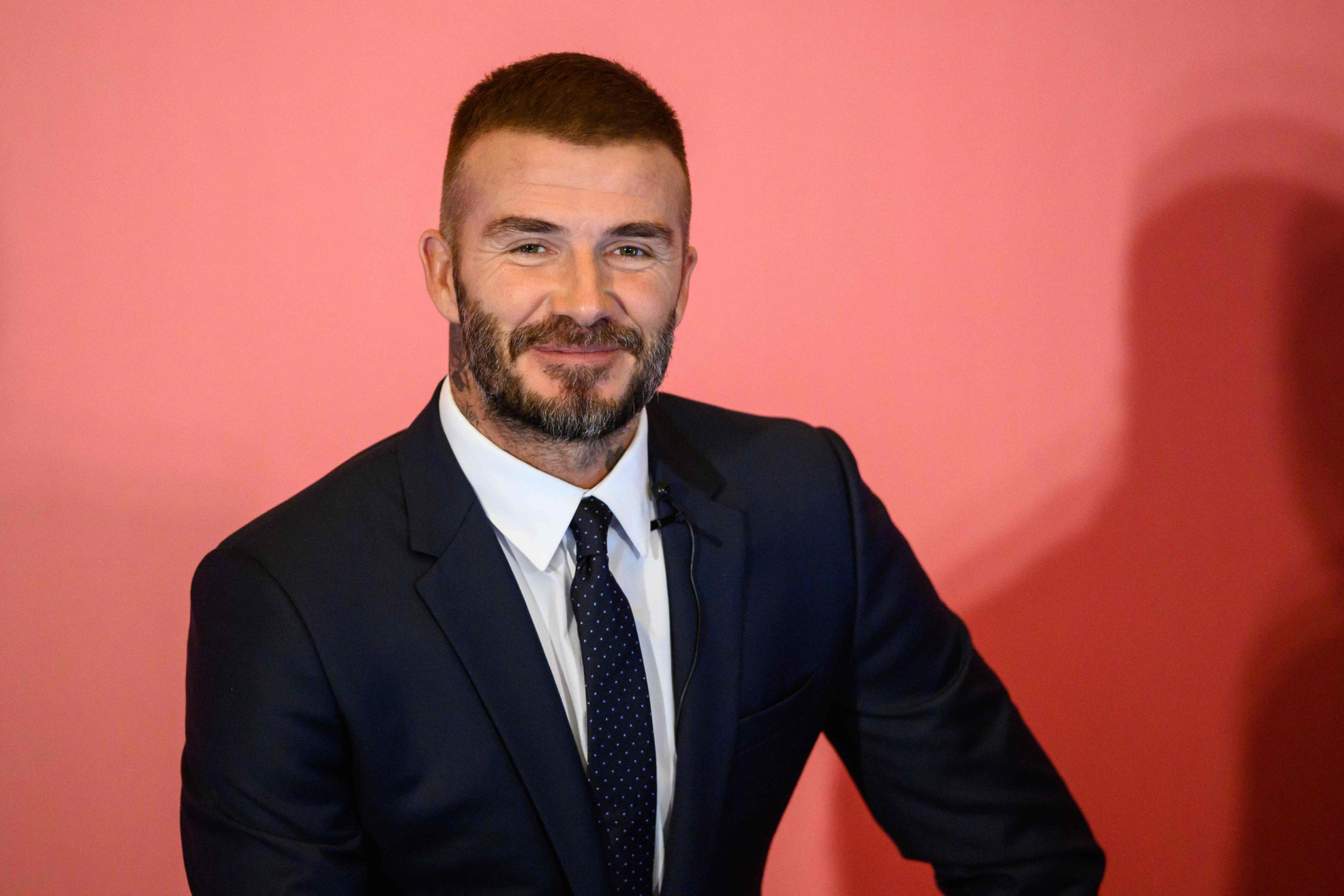 Former England footballer David Beckham speaks during a promotional event where he appeared as the global brand ambassador for insurance company AIA in Hong Kong on September 24, 2018. (Photo by Anthony WALLACE / AFP)ANTHONY WALLACE/AFP/Getty Images