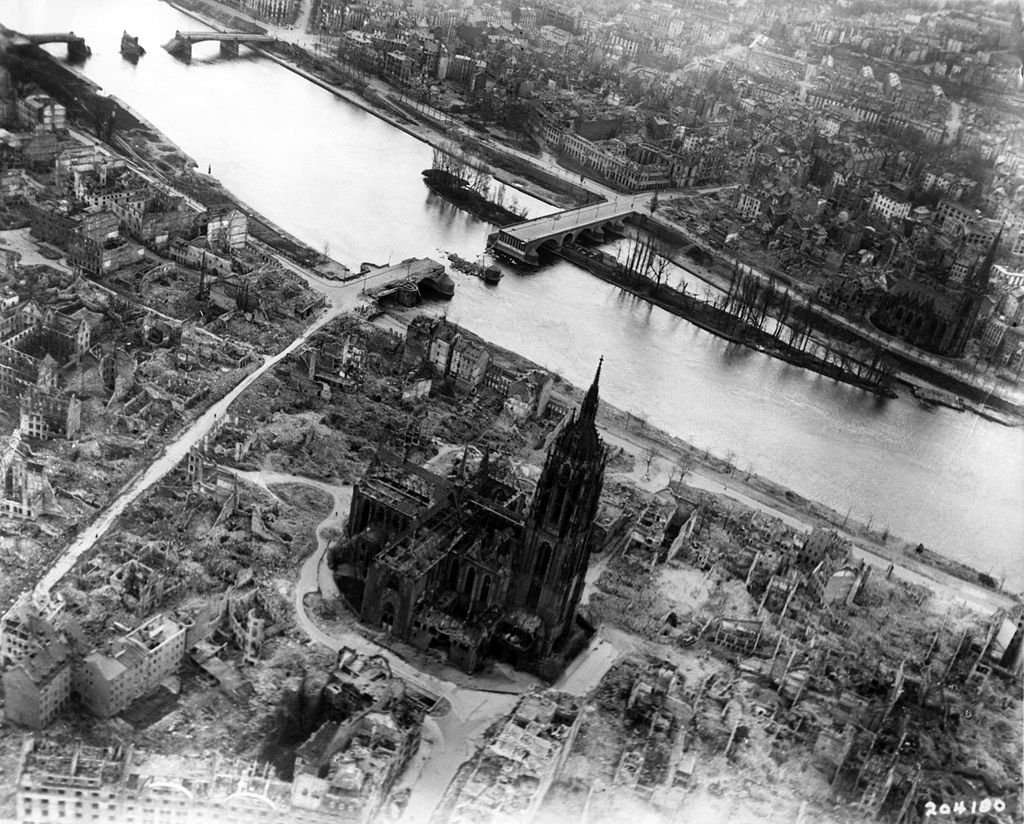 """EMBARGOED TO 0001 WEDNESDAY SEPTEMBER 26 Undated handout photo issued by University of Reading of damage from bombing during WWII around Frankfurt Cathedral in May 1945. Shock waves from huge bombs dropped on Germany during the Second World War were powerful enough to alter the atmosphere at the edge of space, scientists have learned. PRESS ASSOCIATION Photo. Issue date: Wednesday September 26, 2018. The allied bombing raids that began in 1942 caused unparalleled devastation on the ground as cities such as Dresden and Hamburg were reduced to rubble and ash. But new research shows the massive explosions of heavy bombs that included the 10 tonne """"Grand Slam"""" also disturbed the ionosphere hundreds of miles above the Earth. See PA story SCIENCE Bombs. Photo credit should read: University of Reading/PA Wire"""