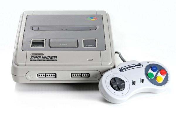 Editorial use only Mandatory Credit: Photo by Neil Godwin/Future/REX/Shutterstock (4377045c) A Super Nintendo Entertainment System Video Game Console And Competition Pro Controller Photographed On A White Background Vintage Game Console Shoot