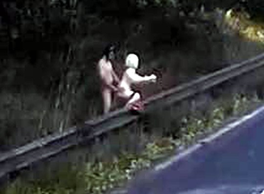 """AN amazing video shows a naked man appearing to get intimate with a blow up doll next to one of Britain's busiest motorways. The jaw-dropping incident shows the man standing behind the doll next to a crash barrier on the M1. The incident, near Northampton, was captured on the dashcam of a HGV on Wednesday 19th of September at 11:10am. The naked man was believed to be standing at the end of the slip road from Northampton Roadchef services at junction 15a of the M1 motorway heading Northbound. The driver who the HGV who wishes to be anonymous said: """"Some people have very strange hobbies and fetishes"""". The bizarre footage shows the HGV on the M1 Northbound with the slip road to its left."""