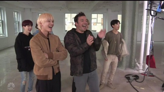 """BGUK_1349966 - ** RIGHTS: WORLDWIDE EXCEPT IN UNITED STATES ** Los Angeles, CA - Boy band BTS try the Fortnite Dance Challenge as they appear on The Tonight Show. In his opening monologue, host Jimmy Fallon introduced BTS as 'the biggest boy band on the plane' and then, after a brief chant led by the fans sitting in the audience, the host showed a clip during which he and the seven members - RM, J-Hope, Jimin, Jin, Jungkook, V, and Suga - took part in the Fortnite Dance Challenge. The eight danced iconic moves such as the Electric Shuffle, The Worm and the Robot, and were then mimicked by characters from the video game. For RM, the leader of BTS was all too happy to whip out the game???s horse riding emote. The rapper gets plenty excited over the dance and he???s even joined on stage by Fallon. And, before long, it is V and Jimin who come out to dance with their leader. Each of the idols have their own emote to dance to, but it is J-Hope who stands out. The rapper is tasked with doing the robot, and the move is a piece of cake for the band???s lead dancer. Also, Jungkook didn't hold back with his take on the worm. BTS also showed Fallon some of the moves to their hit Idol. During the interview portion of the show, BTS and Fallon talked about their time in NYC, their tour, and speaking at the UN. """"I was like so nervous,??? said RM, regarding his speech. ???I was holding up the paper and you could see my hands shaking."""" He also talked about the message of Speak Yourself, saying: """"It's mainly about speaking yourself, like, instead of letting other people speak for you 'cause to truly love ourselves it's important to firstly know who I am, and you know, where I'm from, and what my name is, what my voice is, kinda like that."""" Later on, the group performed their songs Idol and I???m Fine. *BACKGRID DOES NOT CLAIM ANY COPYRIGHT OR LICENSE IN THE ATTACHED MATERIAL. ANY DOWNLOADING FEES CHARGED BY BACKGRID ARE FOR BACKGRID'S SERVICES ONLY, AND DO NOT, NOR ARE THEY INTENDED T"""