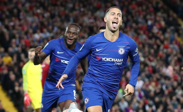 "Chelsea's Eden Hazard celebrates scoring his side's second goal of the game during the Carabao Cup, Third Round match at Anfield, Liverpool. PRESS ASSOCIATION Photo. Picture date: Wednesday September 26, 2018. See PA story SOCCER Liverpool. Photo credit should read: Martin Rickett/PA Wire. RESTRICTIONS: EDITORIAL USE ONLY No use with unauthorised audio, video, data, fixture lists, club/league logos or ""live"" services. Online in-match use limited to 120 images, no video emulation. No use in betting, games or single club/league/player publications."