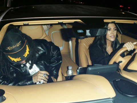 Kourtney Kardashian is the cat that got the cream as she heads out with Luka Sabbat