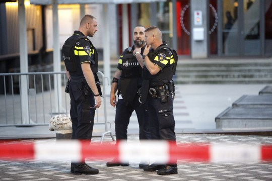 Police stand during the evacuation the Maassilo concert venue after a concert by Californian ban Allah-Las was canceled in relation to a terror attack threat, according to police and the venue, on August 23, 2017, in Rotterdam. (Photo by Arie Kievit / ANP / AFP) / Netherlands OUT (Photo credit should read ARIE KIEVIT/AFP/Getty Images)