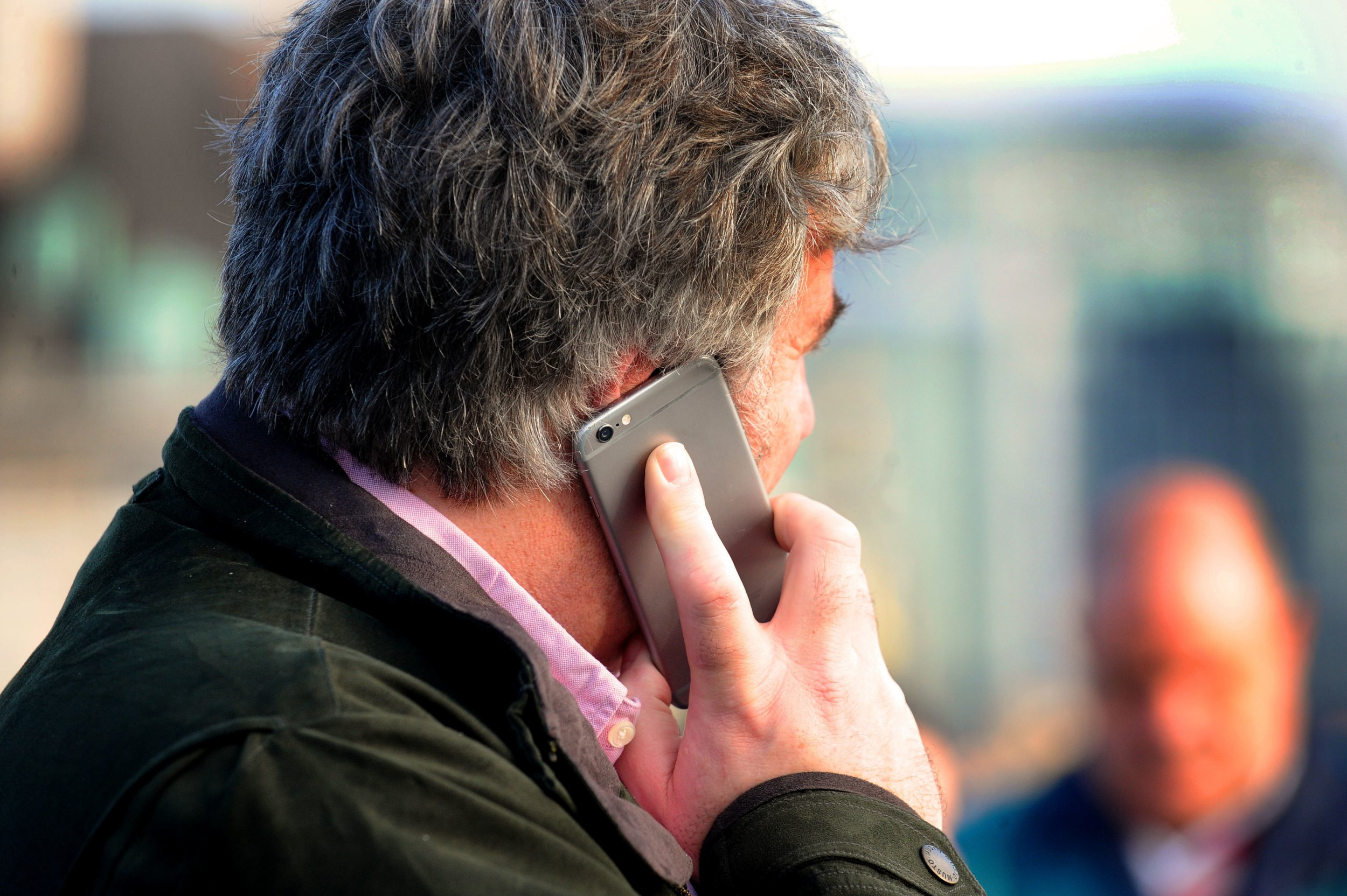 """Undated file photo of a man using a mobile phone in central London. Citizens Advice has lodged a super complaint with the competition watchdog after finding that customers who remain loyal to their utility providers are being penalised by ?4 billion a year. PRESS ASSOCIATION Photo. Issue date: Friday September 28, 2018. The national charity said the practice of overcharging loyal customers was ongoing and widespread and called on the Competition and Markets Authority (CMA) to """"act now to stop people being exploited"""". Research by Citizens Advice found that British consumers are losing ?4.1 billion a year across the five essential mobile, broadband, home insurance, mortgages and savings markets to the """"loyalty penalty"""", with eight in 10 people paying a significantly higher price to at least one of their providers for remaining with them. See PA story CONSUMER Loyalty. Photo credit should read: Lauren Hurley/PA Wire"""