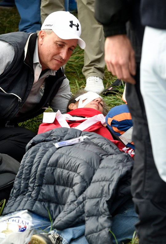 epa07053339 A girl lies on the ground after she was hit by Brooks Koepka's ball, of the USA, on the 6th hole during the Ryder Cup 2018 at The Golf National in Guyancourt, near Paris, France, 28 September 2018. The Ryder Cup 2018 runs from 25 to 30 September. EPA/GERRY PENNY