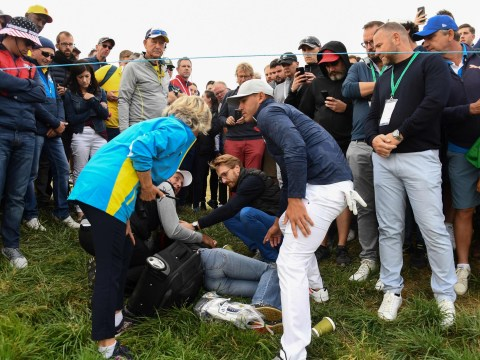 Woman hit in the face by wayward golf ball during Ryder Cup
