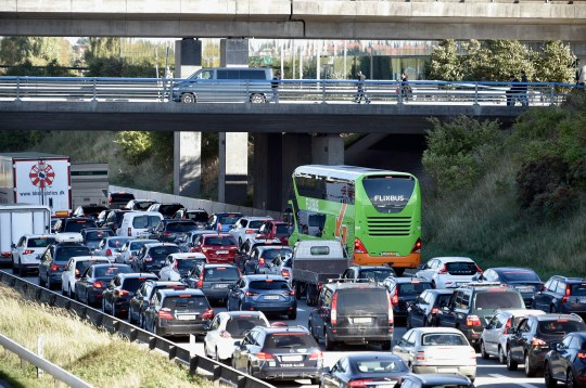 epa07054299 Vehicles jam the street leading to the Oeresund Bridge near Copenhagen, Denmark, 28 September 2018. Media reports state that Danish police closed bridges and ferry connection on the eastern island of Zealand because of a 'major police operation', according to information of the Copenhagen Police on Twitter. No further details on the size and background of the police operation were immediately availabe. EPA/NILS MEILVANG DENMARK OUT