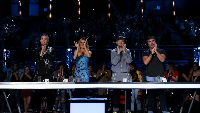 STRICT EMBARGO - NO USE BEFORE 22:05 SATURDAY 29TH SEPTEMBER 2018. EDITORIAL USE ONLY - NO MERCHANDISING Mandatory Credit: Photo by Dymond/Thames/Syco/REX (9903309b) Robbie Williams, Ayda Williams, Louis Tomlinson and Simon Cowell during the performance of Cezar Ouatu 'The X Factor' TV show, Series 15, Episode 9, UK - 29 Sep 2018