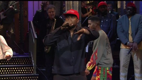 """BGUK_1354499 - ** RIGHTS: WORLDWIDE EXCEPT IN UNITED STATES ** Los Angeles, CA - Kanye West dresses as a water bottle in the first of three performances on Saturday Night Live. On the episode, hosted by Adam Driver,he firstr performed I Love It with Lil Pump. Kanye dressed as a Perrier bottle and Pump was a Fiji bottle as they rapped with Adele Givens projected on a screen behind them. They modified the chorus to, 'You???re such a freaky girl' though Kanye still used profanities throughout the track and had to be bleeped several times. For his second appearance, Kanye brought out Teyana Taylor to play a new song. The song, which leaked earlier this summer, includes the lyrics: ???We got love, love love/You better believe it.??? It appears to features a voice memo from Lauryn Hill, which Taylor previously teased on Twitter. Kanye then performed for a third time as the credits rolled. While wearing a MAGA hat, he invited 070 Shake, Kid Cudi, and Ty Dolla $ign on guitar to play Ghost Town from 'ye'. After the show ended, Kanye stayed on stage and gave a speech to the SNL audience, captured on Chris Rock???s Instagram story. In the clips, Kanye mentions his old promise that he would run for president in 2020. He also addressed his affinity for Trump, saying: """"So many times I talk to a white person about this and they say: ???How could you like Trump, he???s racist???? Well, if I was concerned about racism I would???ve moved out of America a long time ago."""" *BACKGRID DOES NOT CLAIM ANY COPYRIGHT OR LICENSE IN THE ATTACHED MATERIAL. ANY DOWNLOADING FEES CHARGED BY BACKGRID ARE FOR BACKGRID'S SERVICES ONLY, AND DO NOT, NOR ARE THEY INTENDED TO, CONVEY TO THE USER ANY COPYRIGHT OR LICENSE IN THE MATERIAL. BY PUBLISHING THIS MATERIAL , THE USER EXPRESSLY AGREES TO INDEMNIFY AND TO HOLD BACKGRID HARMLESS FROM ANY CLAIMS, DEMANDS, OR CAUSES OF ACTION ARISING OUT OF OR CONNECTED IN ANY WAY WITH USER'S PUBLICATION OF THE MATERIAL* Pictured: Kanye West BACKGRID UK 29 SEPTEMBER 20"""