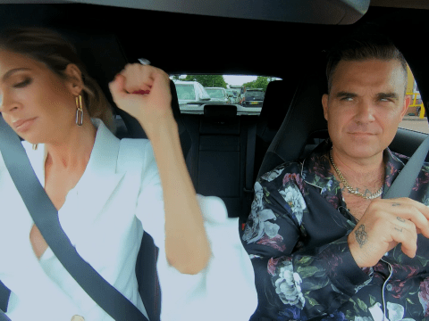 Robbie Williams isn't happy as wife Ayda Field calls One Direction 'best boy band ever' while they drive to X Factor