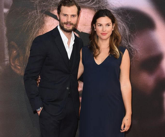 Jamie Dornan and pregnant wife Amelia Warner are seriously loved-up as he jokes he needs to 'put a cork in it'