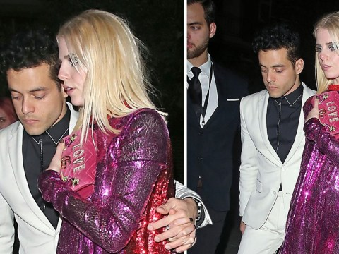 Rami Malek and Boheman Rhapsody co-star Lucy Boynton cling into one another as they slink out of bar at 4.30am
