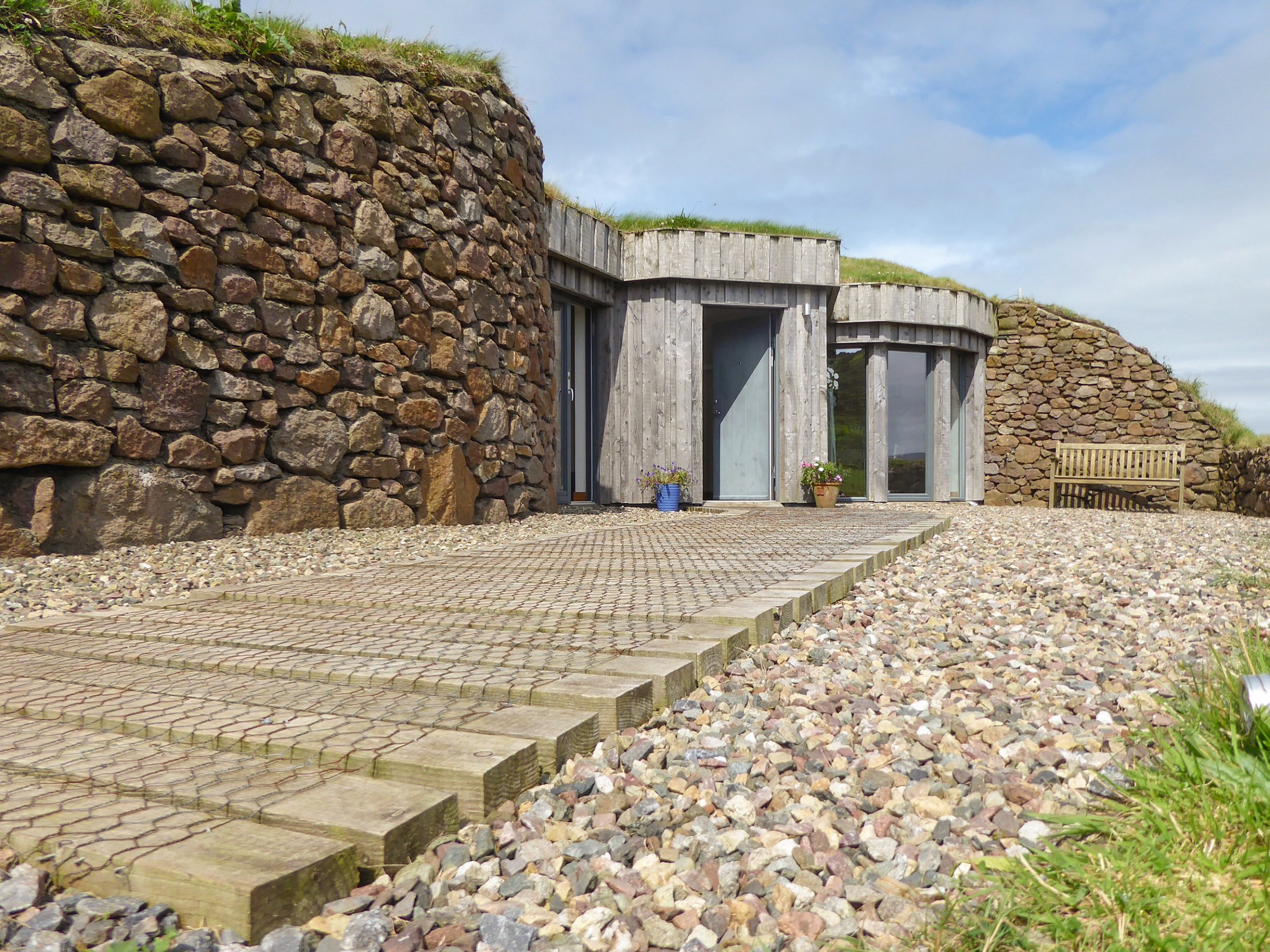 Exterior. LIVE like the Flinstones without giving up any luxury in this stunning cottage built into the hillside which is available to rent for ??63.50 per person per night. Incredible images show the exterior of the one-bed cottage which blends into the countryside with its natural stones walls and large windows dug into the hill. Other striking shots show the cosy living room complete with wood-burning stove, modern kitchen and sleek, tiled bathroom. High Trodigal is located in Machrihanish, near Campbeltown, Argyll and Bute, Scotland ans is currently listed on www.cottages.com for ??889 for a week???s stay. Cottages.com / mediadrumimages.com