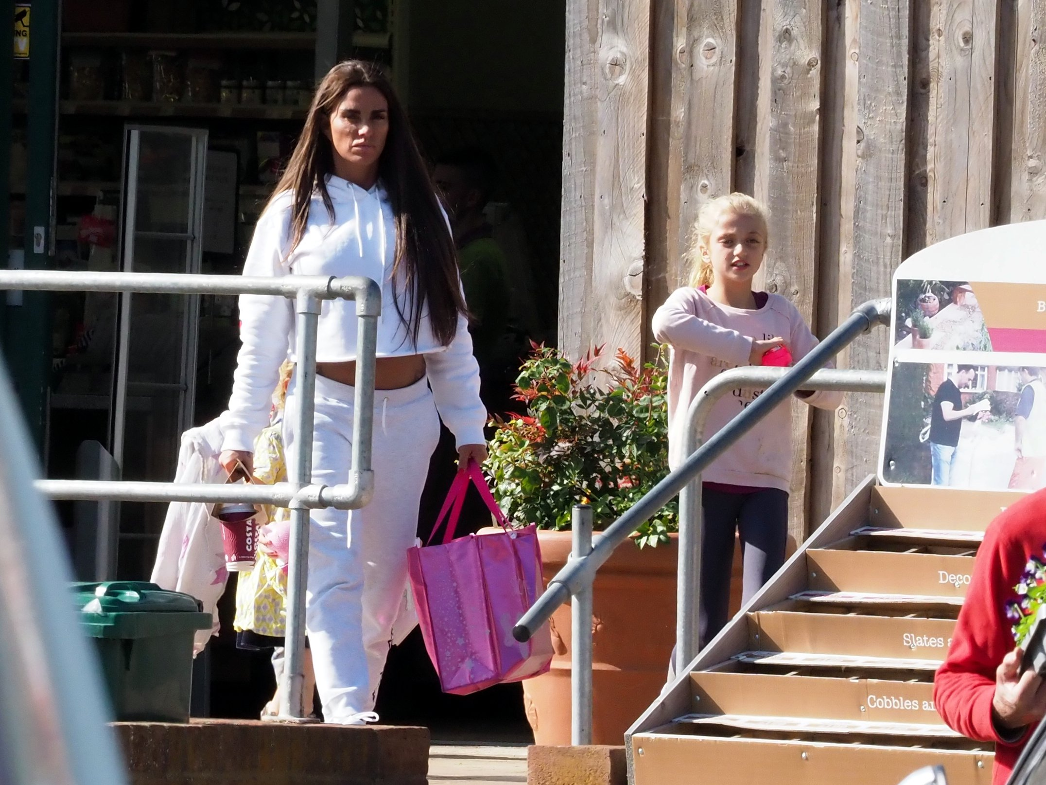 EXCLUSIVE ALL ROUNDER ***MINIMUM FEE ??250 PER PICTURE APPLIES*** Katie Price is seen for the first time since submitting to a rehab clinic out shopping with three of her children in West Sussex. Despite her ongoing reported financial woes Katie drove off in a brand new Range Rover Sport which cost from ??63000. The Reality TV star looked healthy and happy as she was seen grabbing a coffee with children Princess, Jett and Bunny. 29 September 2018. Please byline: Vantagenews.com UK clients should be aware children's faces may need pixelating.