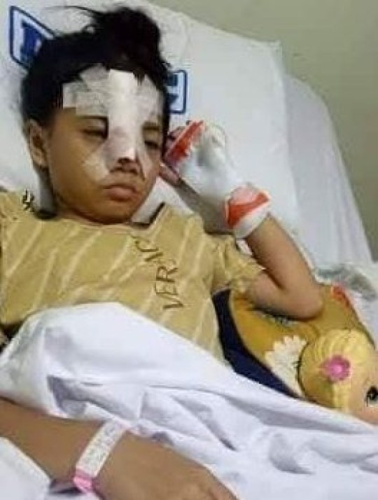 Eight-year-old Brielle Minia in hospital last Friday (28/09) after tackling gun wielding robbers who mugged her father.??????NEWS COPY - WITH VIDEO AND PICTURES This is the astonishing moment an eight-year-old girl tackles gun-wiedling robbers moments after they mugged her father. Schoolgirl Brielle Minia was playing on the driveway outside her home when the four men walked past posing as DVD sellers last Thursday afternoon in Cavite, Philippines. Three masked men approached her dad - who had just returned home from work in a white 4x4 - and held him up at gunpoint to steal his cash while one of the gang raided the family home. The group ran back down in the driveway in the opposite direction - with the only person between them and their getaway motorcycles being the little girl, who was walking back to see what the noise was. Wearing a pink dress and pigtails, Brielle bravely lunged at the same man who had been holding the silver semi-automatic handgun. She ripped open his bag, sending the contents he had stolen onto the flood. The youngster frantically tried to scoop it up as the robber towered over her then made a break for freedom. But incredibly, the fearless youngster climbed to her feet and sprinted after the robber before hurling herself at them for a second time as they climbed onto their bikes.??????SEE WIRE FOR FULL COPY AND VIDEO DESK