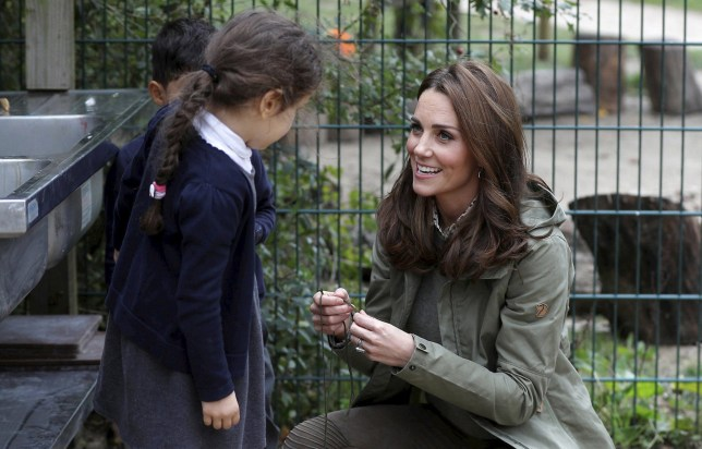 Britain's Kate, the Duchess of Cambridge reacts with children as she visits the Sayers Croft Forest School and Wildlife Garden at Paddington Recreation Ground, in London, Tuesday Oct. 2, 2018. (Peter Nicholls/Pool Photo via AP)