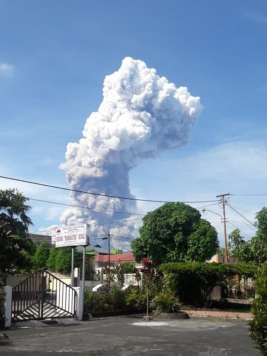 """This handout picture taken and released on October 3, 2018 by Indonesia's National Agency for Disaster Management (BNPB) shows Soputan volcano erupting ash up to 4,000 metres above the crater, as seen from Pinabetengan in Southeast Minahasa, North Sulawesi Province. - The state disaster agency warned people to stay at least four kilometres away, but said there was no need to evacuate for the time being. (Photo by Handout / Indonesia's National Disaster Agency / AFP) / RESTRICTED TO EDITORIAL USE - MANDATORY CREDIT """"AFP PHOTO / National Agency for Disaster Management (BNPB)"""" - NO MARKETING NO ADVERTISING CAMPAIGNS - DISTRIBUTED AS A SERVICE TO CLIENTSHANDOUT/AFP/Getty Images"""