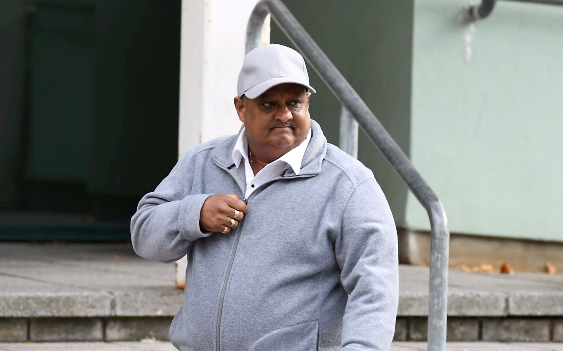 Himwanth Ramkishun pictured leaving court. See SWNS story SWPLrape; A laundryman accused of raping an elderly woman at a city care home left behind a condom, a jury was told. A court heard that the contraceptive was later recovered by Himwanth Ramkishun?s wife, herself a senior staff member there. Duty manager Ivorine Ramkishun called the police - unaware that the condom contained traces of her husband?s DNA, the jury was told. Himwanth Ramkishun, aged 54, has gone on trial at Plymouth Crown Court accused of raping the 76-year-old dementia sufferer.