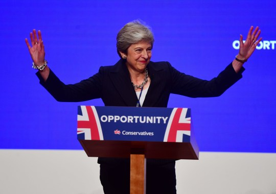 Prime Minister Theresa May greets the audience as she arrives on stage to make her speech at the Conservative Party annual conference at the International Convention Centre, Birmingham.PRESS ASSOCIATION Photo. Picture date: Wednesday October 3, 2018. See PA story TORY Main. Photo credit should read: Victoria Jones/PA Wire