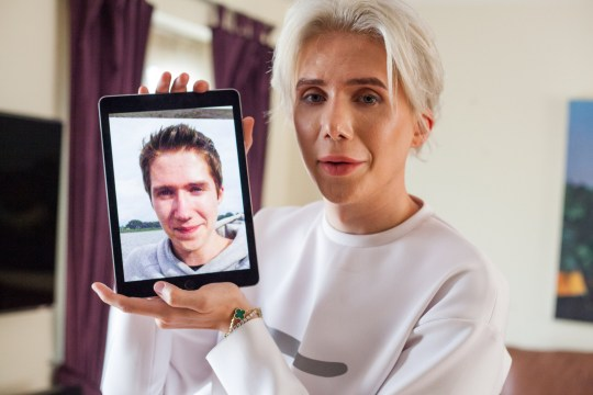 *** VIDEO AVAILABLE *** LONDON, UNITED KINGDOM - AUGUST 2018: Oli London posing with an old photograph of himself on August 2018 in London, England. A CAUCASIAN man has spent over ?75,000 on surgeries to look like his Korean boyband idol. Oli London first discovered K-pop boyband BTS when he was living in Korea in 2013. ,K-pop is a popular genre of music from Korea, and BTS is currently one of the most famous K-pop bands in the world. The Londoner is particularly infatuated with lead vocalist from the band, Jimin, and he has strived to look like his idol for five years. PHOTOGRAPH BY Marcus Hessenberg / Barcroft Images