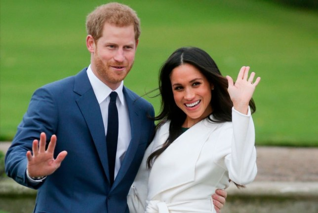 Britain's Prince Harry and his fianc??e US actress Meghan Markle pose for a photograph in the Sunken Garden at Kensington Palace in west London on November 27, 2017, following the announcement of their engagement. - Britain's Prince Harry will marry his US actress girlfriend Meghan Markle early next year after the couple became engaged earlier this month, Clarence House announced on Monday. (Photo by Daniel LEAL-OLIVAS / AFP) (Photo credit should read DANIEL LEAL-OLIVAS/AFP/Getty Images)