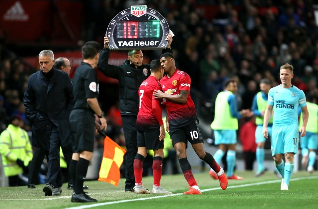 Manchester United's Marcus Rashford (right) is substituted off the pitch for Alexis Sanchez (left)