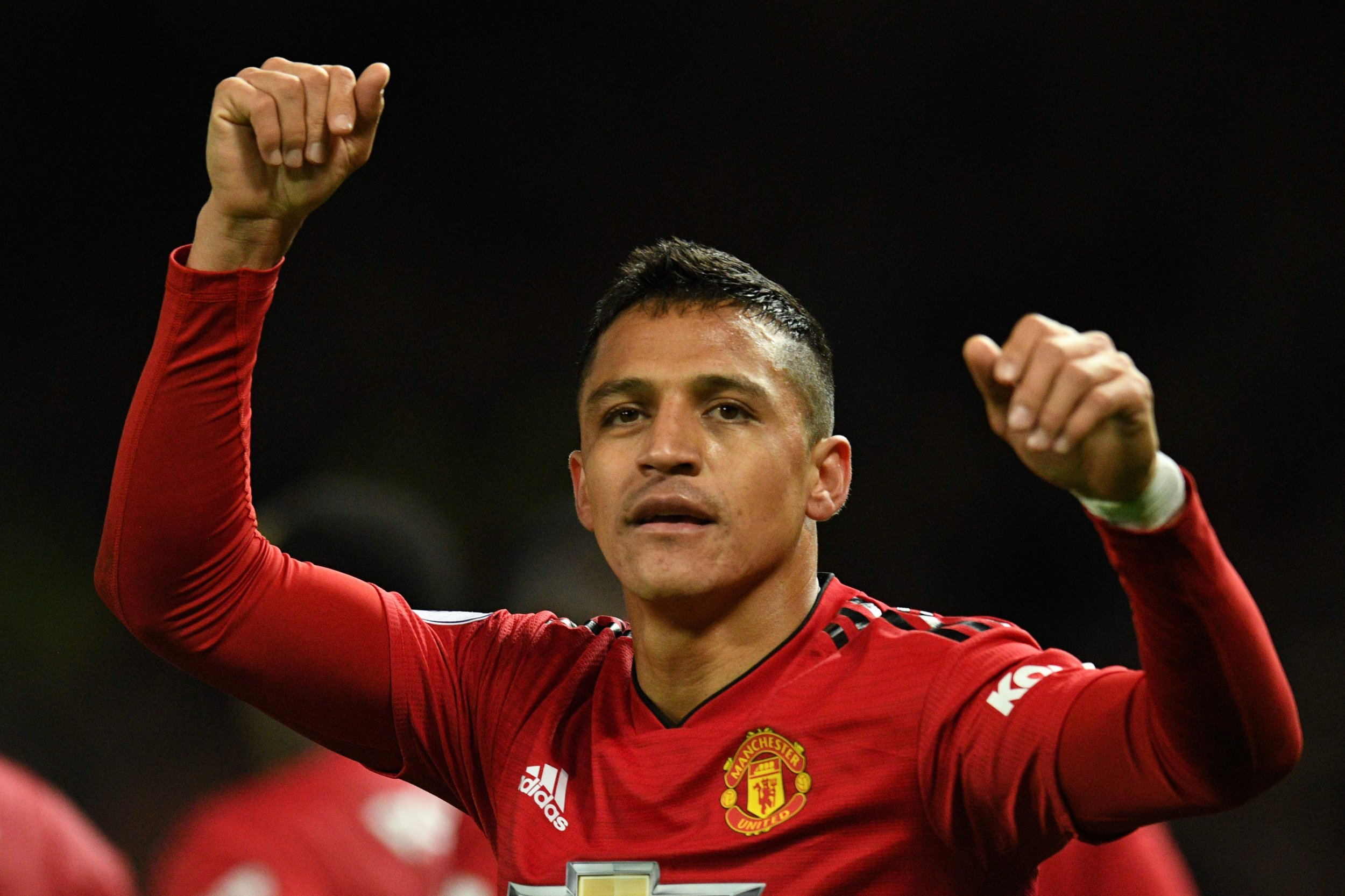 Manchester United's Chilean striker Alexis Sanchez celebrates after scoring the team's third goal during the English Premier League football match between Manchester United and Newcastle at Old Trafford in Manchester, north west England, on October 6, 2018. (Photo by Oli SCARFF / AFP) / RESTRICTED TO EDITORIAL USE. No use with unauthorized audio, video, data, fixture lists, club/league logos or 'live' services. Online in-match use limited to 120 images. An additional 40 images may be used in extra time. No video emulation. Social media in-match use limited to 120 images. An additional 40 images may be used in extra time. No use in betting publications, games or single club/league/player publications. / OLI SCARFF/AFP/Getty Images
