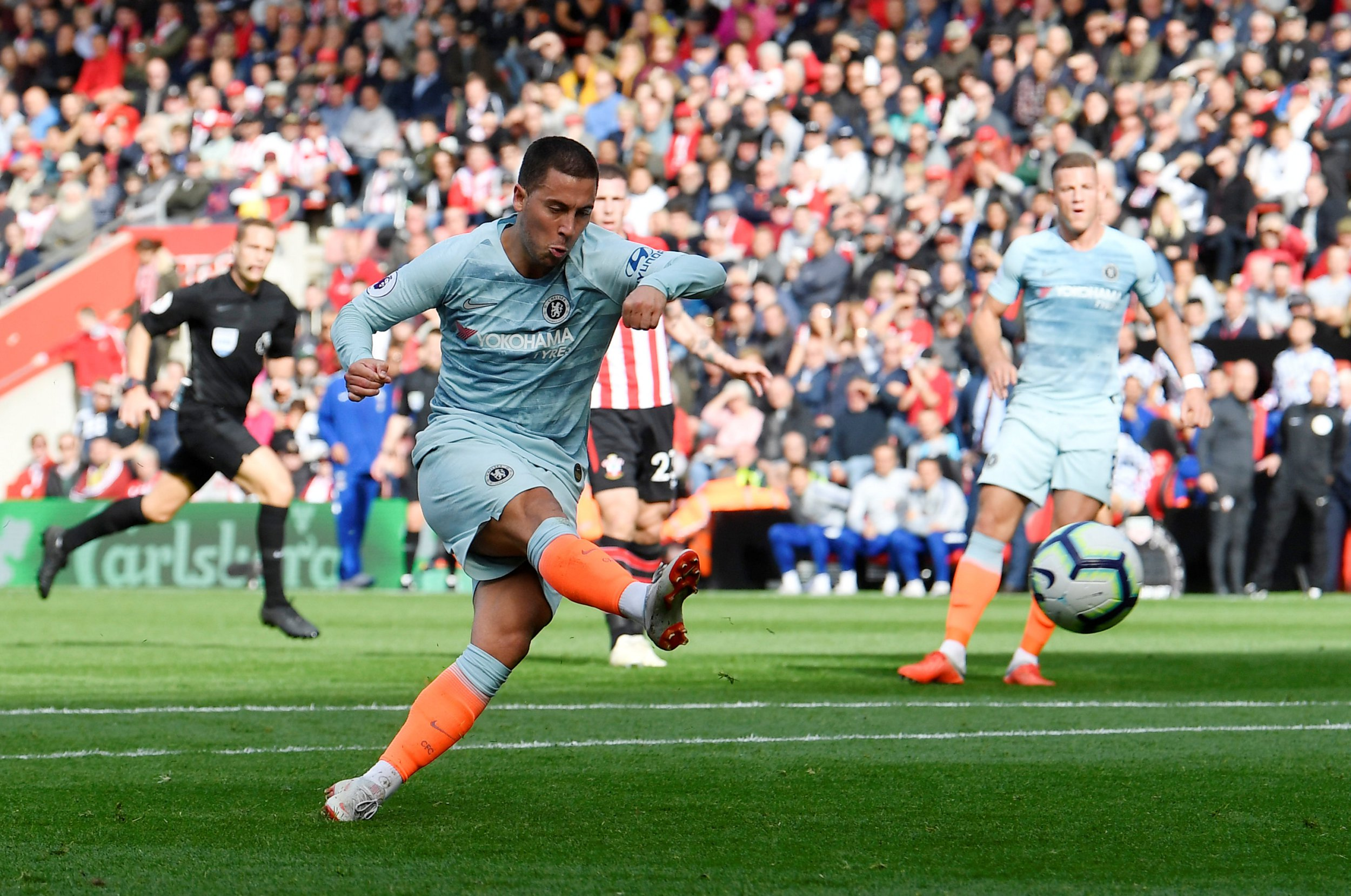 "Soccer Football - Premier League - Southampton v Chelsea - St Mary's Stadium, Southampton, Britain - October 7, 2018 Chelsea's Eden Hazard scores their first goal REUTERS/Toby Melville EDITORIAL USE ONLY. No use with unauthorized audio, video, data, fixture lists, club/league logos or ""live"" services. Online in-match use limited to 75 images, no video emulation. No use in betting, games or single club/league/player publications. Please contact your account representative for further details."