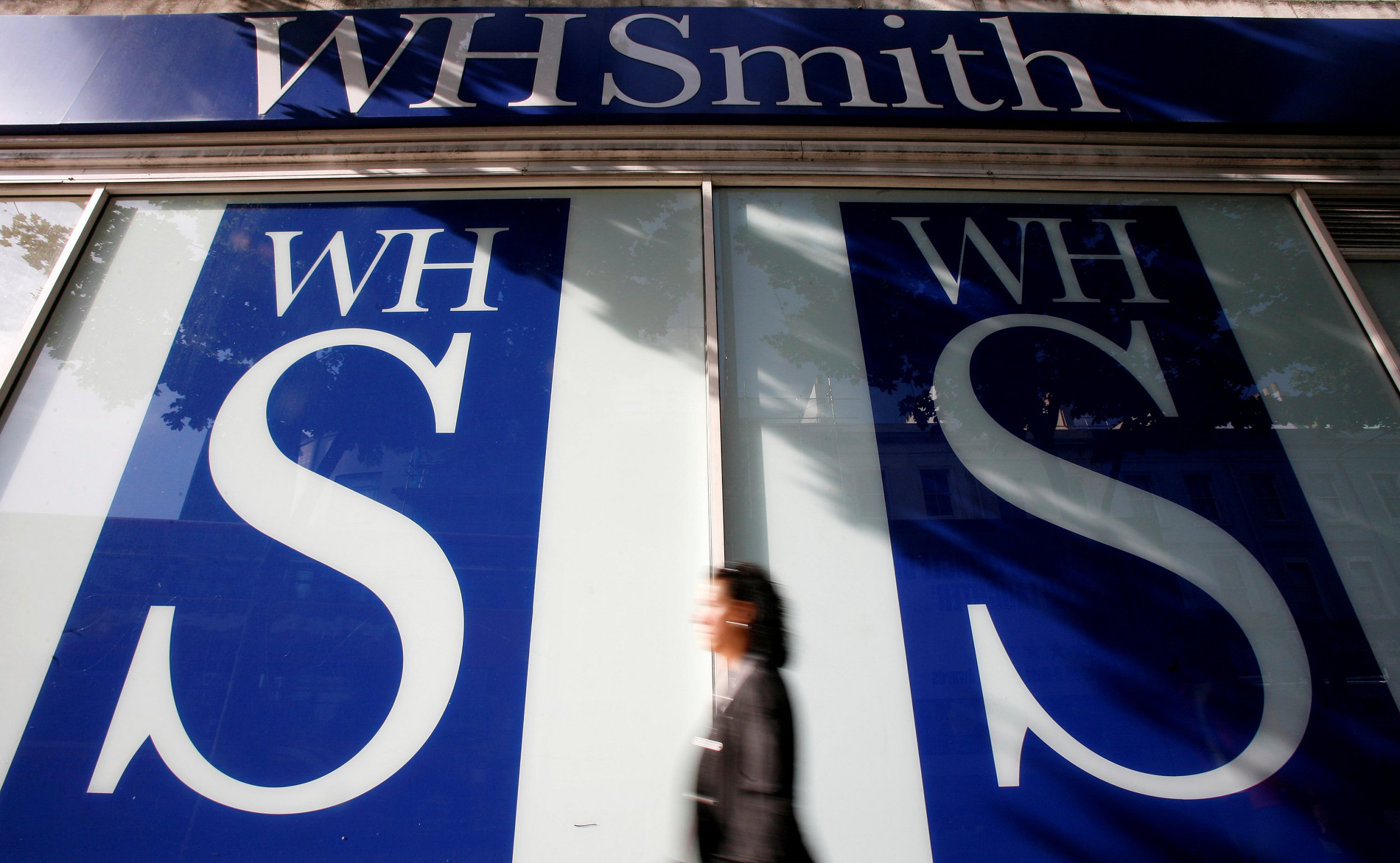 FILE PHOTO: Pedestrians walk past a WH Smith shop, in London October 6, 2008. REUTERS/Alessia Pierdomenico/File Photo GLOBAL BUSINESS WEEK AHEAD