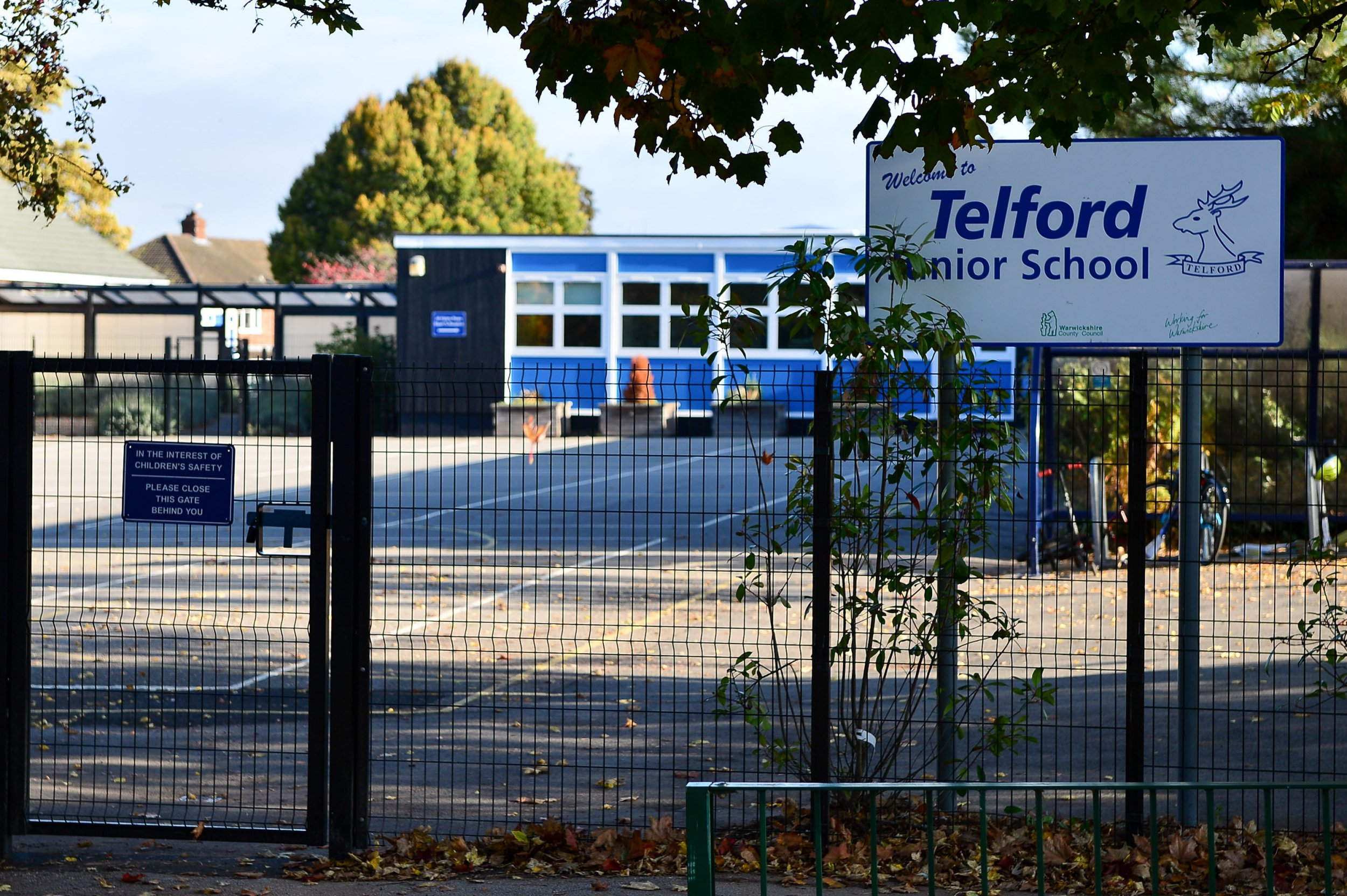 "GV of Telford Junior school in Cubbington, Warwickshire where the school are thinking of changing the uniform to hoodies. October 9 2018. Parents have blasted a junior school over plans to scrap the existing uniform and replace it with tracksuits and HOODIES. See SWNS story SWMDschool. School chiefs claim they want to help cash-strapped families save money by telling all parents to kit their children out in casual sportswear. If the plans are approved, pupils will wear blue-and-white tracksuit bottoms and a hoodie top emblazoned with the school crest. The current policy of pupils wearing black shoes will also be ditched in favour of non-branded white or black trainers. Parents have been asked to vote on the proposals - which have the backing of governors - which could come into force next year. Telford Junior School, in Leamington Spa, Warks., says the new uniform would consist of ""tracksuit bottoms, trainers, white sports socks, hoodie or zoodie in school colours with the school logo."" Last week headteacher Richard Siviter wrote to parents, saying: ""This uniform would be worn throughout the day, without the need to change into games kit for PE/games lessons."""