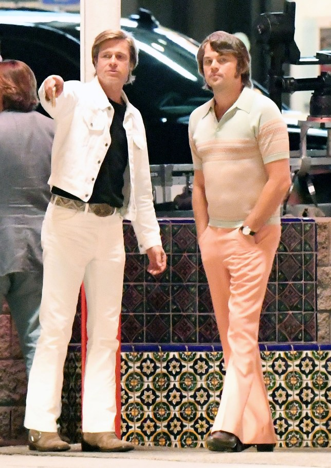Leonardo DiCaprio sports a pair of tight pink pants while Brad Pitt wears an all white denim suit while filming night scenes with classic cars on the set of Once upon a time in Hollywood at Casa Vega on Ventura Blvd in Sherman Oaks, California on Monday night. Brad and Leo drove in a classic Cadillac while filming the scenes with Quinten Tarantino directing. 08 Oct 2018 Pictured: Brad Pitt and Leonardo Dicaprio. Photo credit: GAC/MEGA TheMegaAgency.com +1 888 505 6342