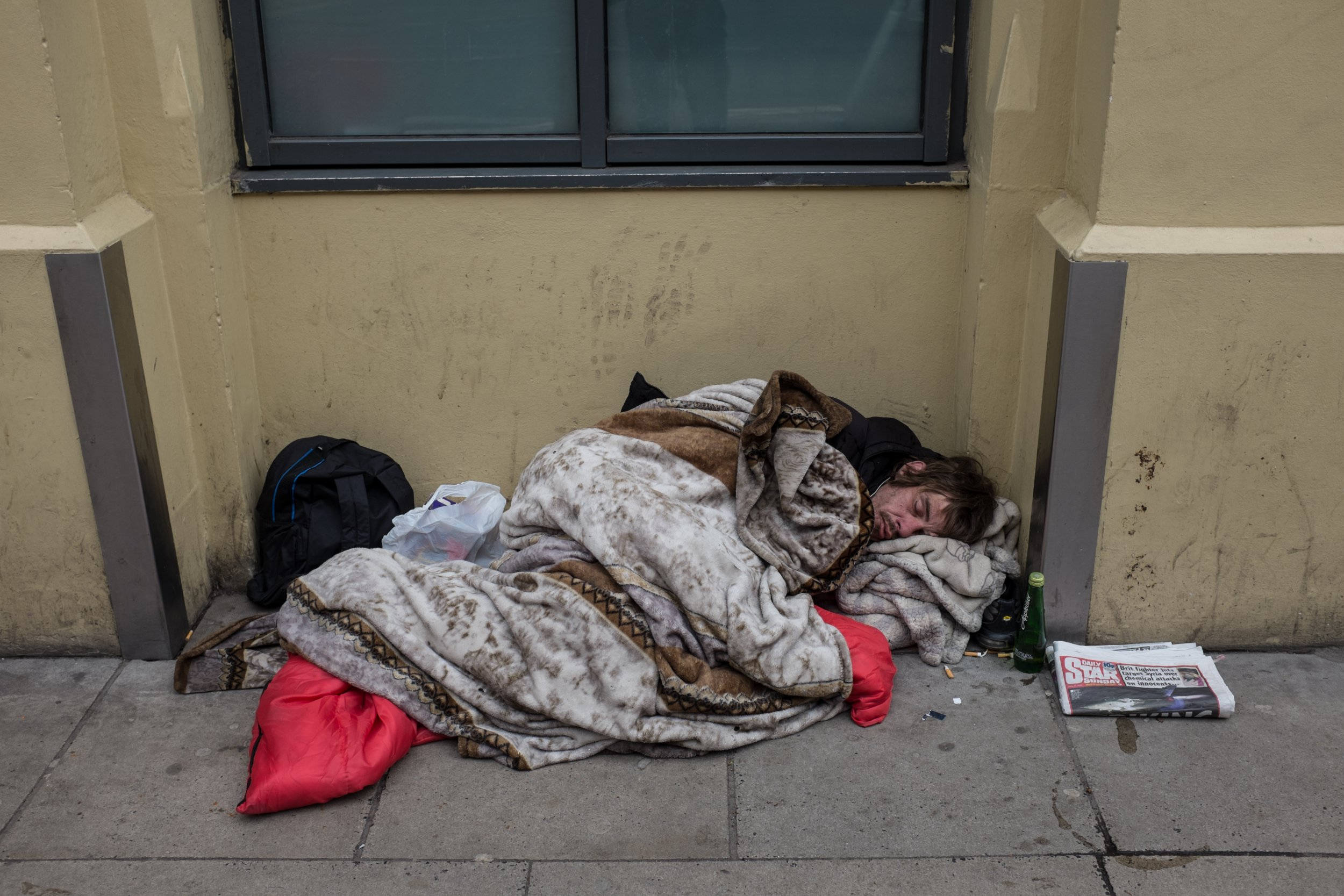 MANCHESTER, MANCHESTER,, UNITED KINGDOM - 2018/04/15: A homeless man sleeps in a pedestrian pathway in Manchester city center. Greater Manchester is a remarkable city in the northwest of England with a lush industrial heritage. The Castle field conservation areas 18th-century canal system recalls the citys days as a textile powerhouse, and visitors can trace this history at the interactive Museum of Science & Industry. (Photo by Rahman Hassani/SOPA Images/LightRocket via Getty Images)