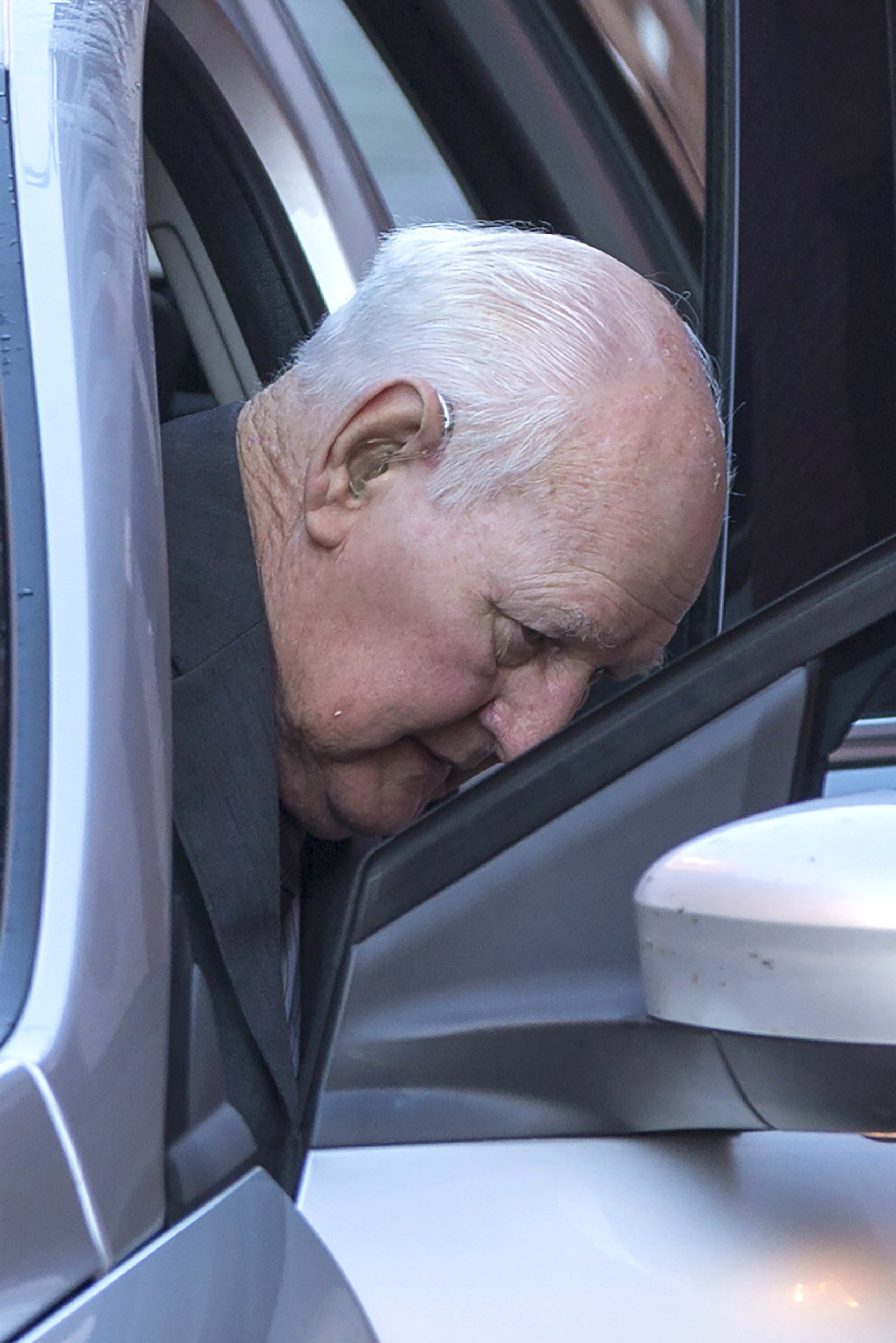 """?? Licensed to London News Pictures. 10/10/2018. Leeds UK. Former police officer 83 year old David Lomax arrives at Leeds Crown Court this morning. Lomax is accused of raping a woman in 1978 because she was unable to pay a fine. Lomax was in his 40's at the time & worked as a warrant officer with West Yorkshire Police. It is alleged that David Lomax had gone to the woman's address two weeks before the alleged offence to collect payment but had agreed to give her extra time to find the money. He then allegedly returned to on the 20th October but the woman was still unable to pay. The court heard Mr Lomax had told the woman he would have to take her to the police station but then put his hand on her shoulder and said: """"Well we could solve this."""" He then allegedly led the woman into her bedroom & raped her against a wall before leaving. The court heard the woman reported it to police several days later and a DNA sample was retrieved from a towel. Jurors at Leeds Crown Court were told Mr Lomax, was charged after his DNA profile was matched in a cold case review in 2016. Photo credit: Andrew McCaren/LNP"""