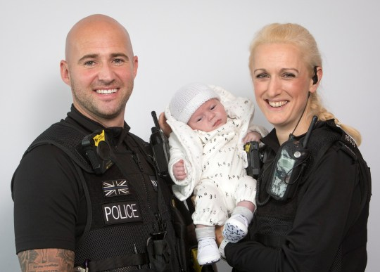 Two hero police officers have been praised for helping to save the life of a newborn baby after he began to choke and stopped breathing. The officers had stopped at a set of traffic lights in Bolton, Manchester, in the early hours of August 29 when they were approached by the tot's distraught parents who were waiting for an ambulance. The boy's father had managed to stabilise him by performing CPR, before he was rushed to hospital by PC Sweeney and PC Slater. PC Kieran Sweeney drove and PC Claire Slater continued to give first aid to baby Isaac, who was just six days old.