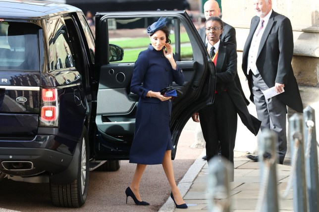The Duchess of Sussex arrives ahead of the wedding of Princess Eugenie to Jack Brooksbank at St George's Chapel in Windsor Castle. PRESS ASSOCIATION Photo. Picture date: Friday October 12, 2018. See PA story ROYAL Wedding. Photo credit should read: Gareth Fuller/PA Wire