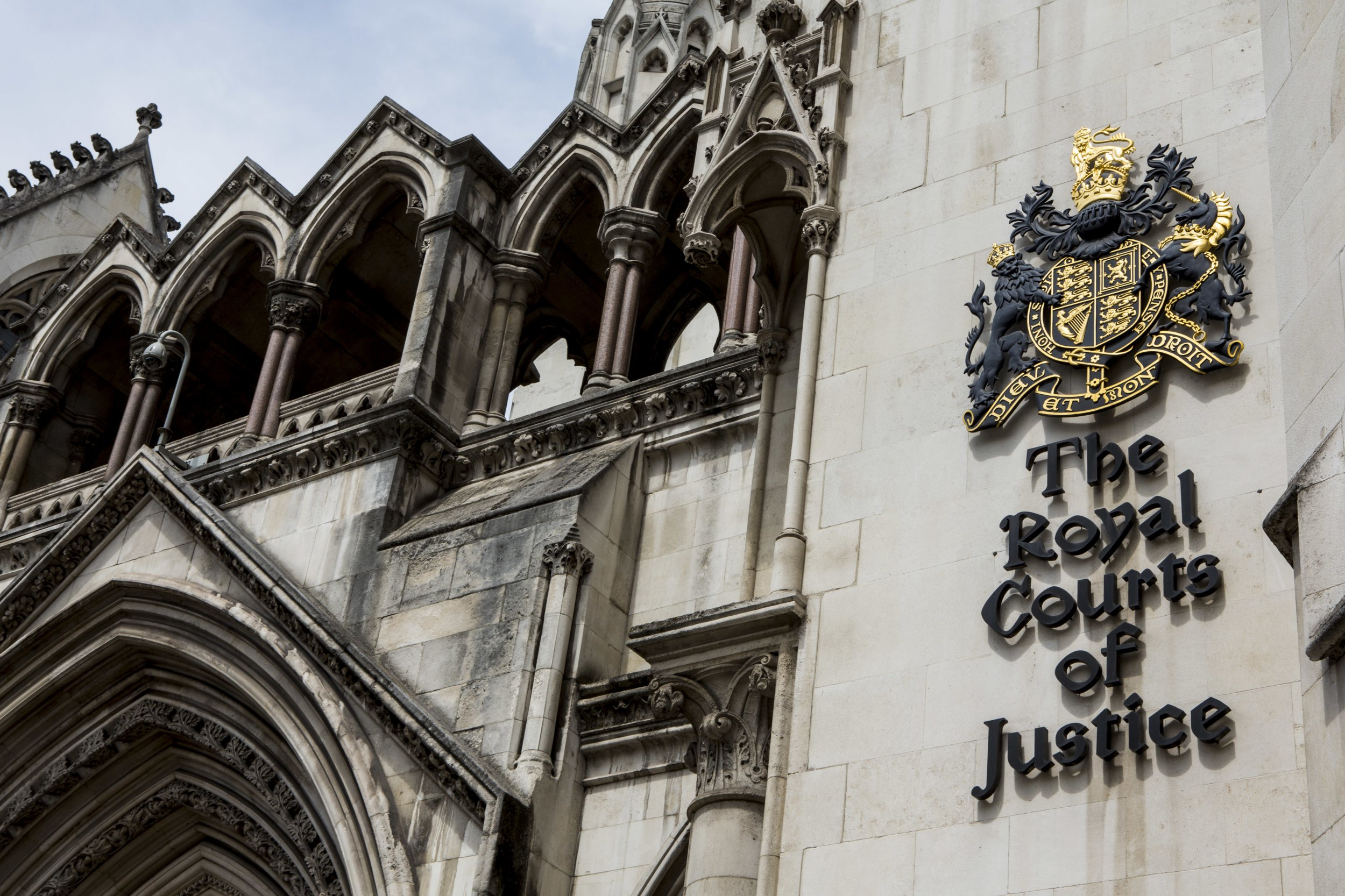 The sign outside The Royal Courts of Justice, commonly called the Law Courts, is a court building in London which houses both the High Court and Court of Appeal of England and Wales. London, UK. (Photo by In Pictures Ltd./Corbis via Getty Images)