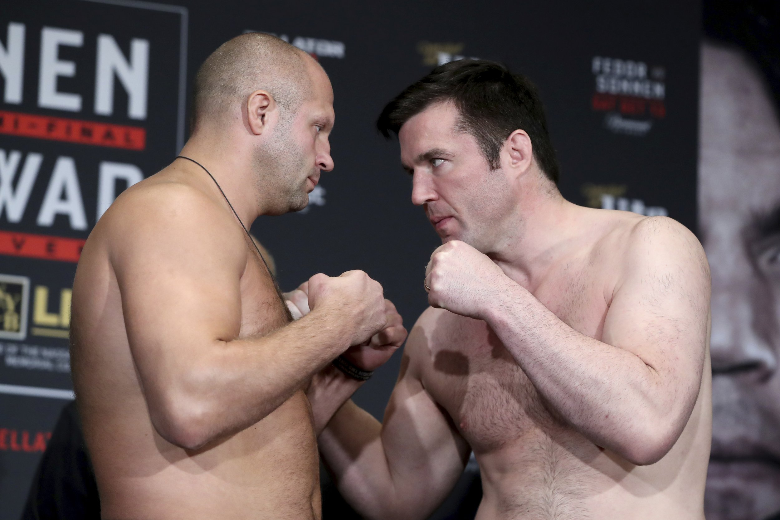 Fedor Emelianenko, left, and Chael Sonnen square off during the ceremonial weigh-in before Bellator 208 on Friday, October 12, 2018, in Melville, NY. (AP Photo/Gregory Payan)