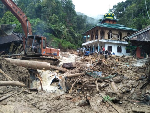 At least 22 dead after flash floods and landslides flatten school in Indonesia