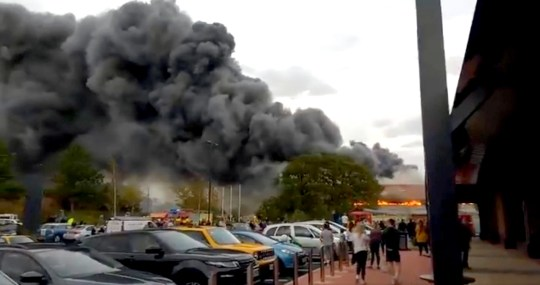 Undated handout photo taken from the Twitter feed of @CASPhotos of plumes of smoke that could be seen emanating from the B&M in York's Clifton Moor retail park. PRESS ASSOCIATION Photo. Issue date: Saturday October 13, 2018. The A1237 has been closed between Wigginton and Clifton Moor as the smoke has created hazardous conditions for drivers, North Yorkshire Police said. See PA story FIRE York. Photo credit should read: Charles Spencer/Twitter/PA Wire NOTE TO EDITORS: This handout photo may only be used in for editorial reporting purposes for the contemporaneous illustration of events, things or the people in the image or facts mentioned in the caption. Reuse of the picture may require further permission from the copyright holder.