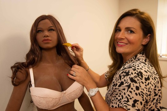 Jade Stanley, pictured, and Steph Kemp, from Halesowen, Dudley, Midlands, offer a synthetic sex doll hire service. With 'Brandy' Credit: BPM Media